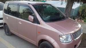 Slide_mitsubishi-ek-wagon-m-2012-11507556