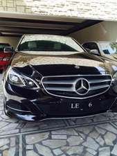 Slide_mercedes-benz-e-class-e-300-2014-11595564