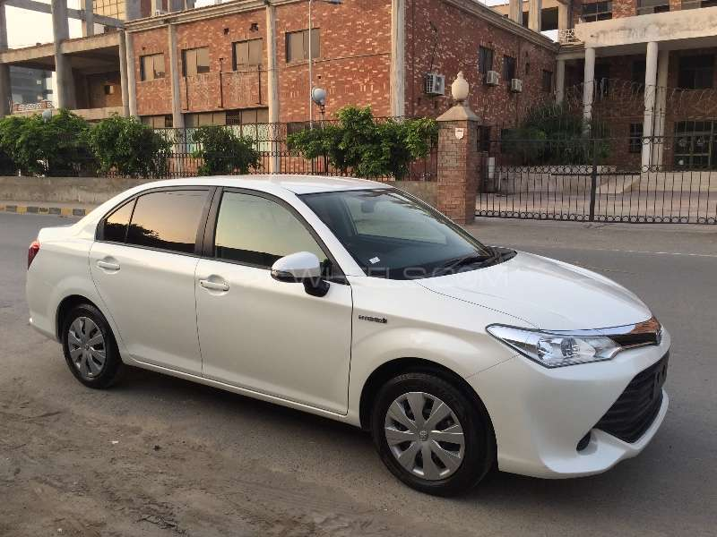 toyota corolla axio hybrid 1 5 2015 for sale in faisalabad