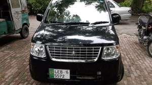 Slide_mitsubishi-ek-wagon-limited-2-2012-12627177