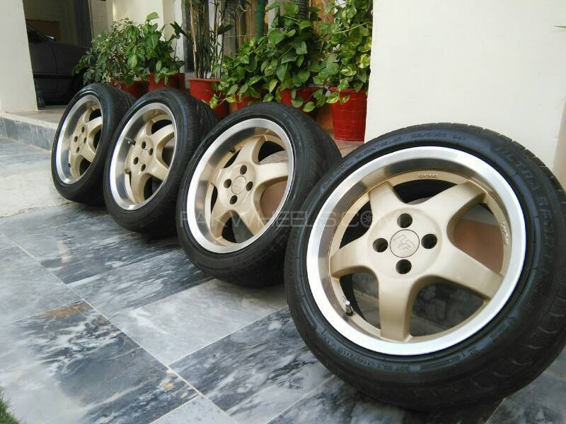 "16"" Japanese alloys with tires Image-1"