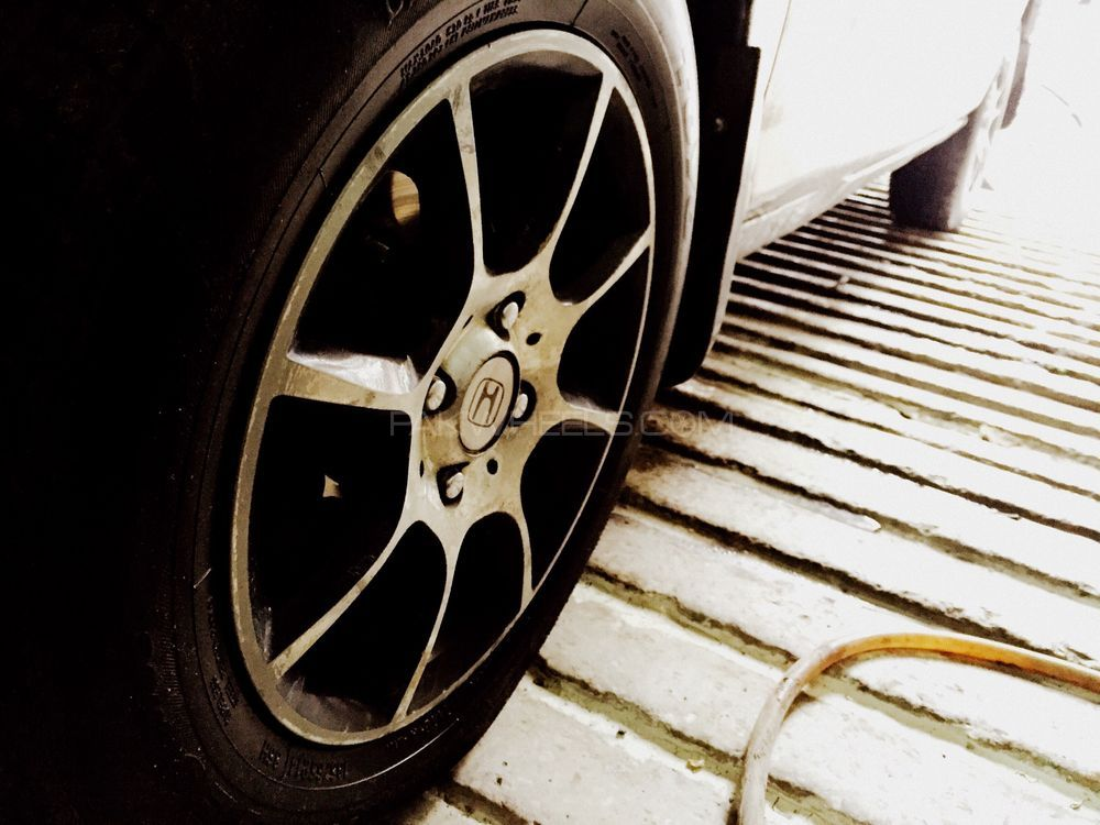 14 inch rim in very good condition with toyo japani tyres  Image-1