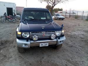 Slide_mitsubishi-pajero-evolution-1999-14462178