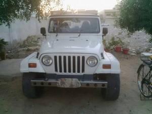 Slide_jeep-wrangler-sahara-1998-14841329