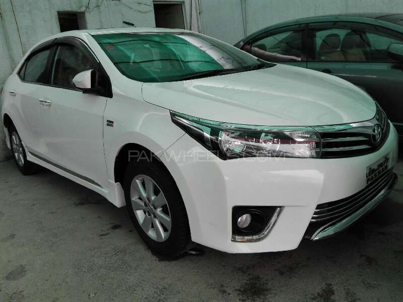 Toyota Corolla Altis 1 8 Grande 2015 Price In Pakistan Specifications Features Review Pics as well Toyota Corolla 2005 For Sale In Islamabad 968321 together with Toyota Corolla 2015 For Sale In Lahore 1990652 as well Toyota Corolla 2017 For Sale In Islamabad 2005758 further Enfim Toyota Corolla Ganha Central Multimidia Na Linha 2014. on toyota altis radio