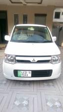 Slide_mitsubishi-ek-wagon-limited-2-2013-15247359