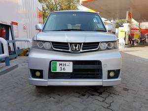 Slide_honda-zest-spark-g-turbo-2011-15799561