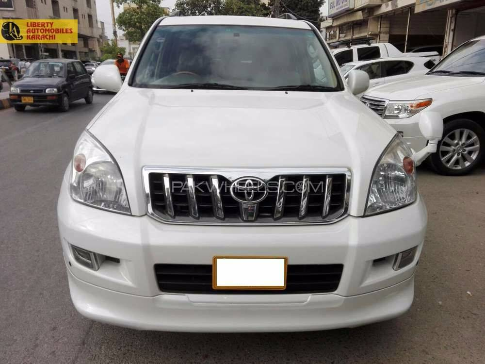 TOYOTA PRADO 2008  TZG REG 2014  PEARL WITH BEIGE ROOM ORGNAL TV MULTI  COOL BOX  SUNROOF ORGNAL BODY KIT  HEIGHT CONTROL FULL  HOUSE NO MINUS OPTION JUST LIKE BRAND NEW