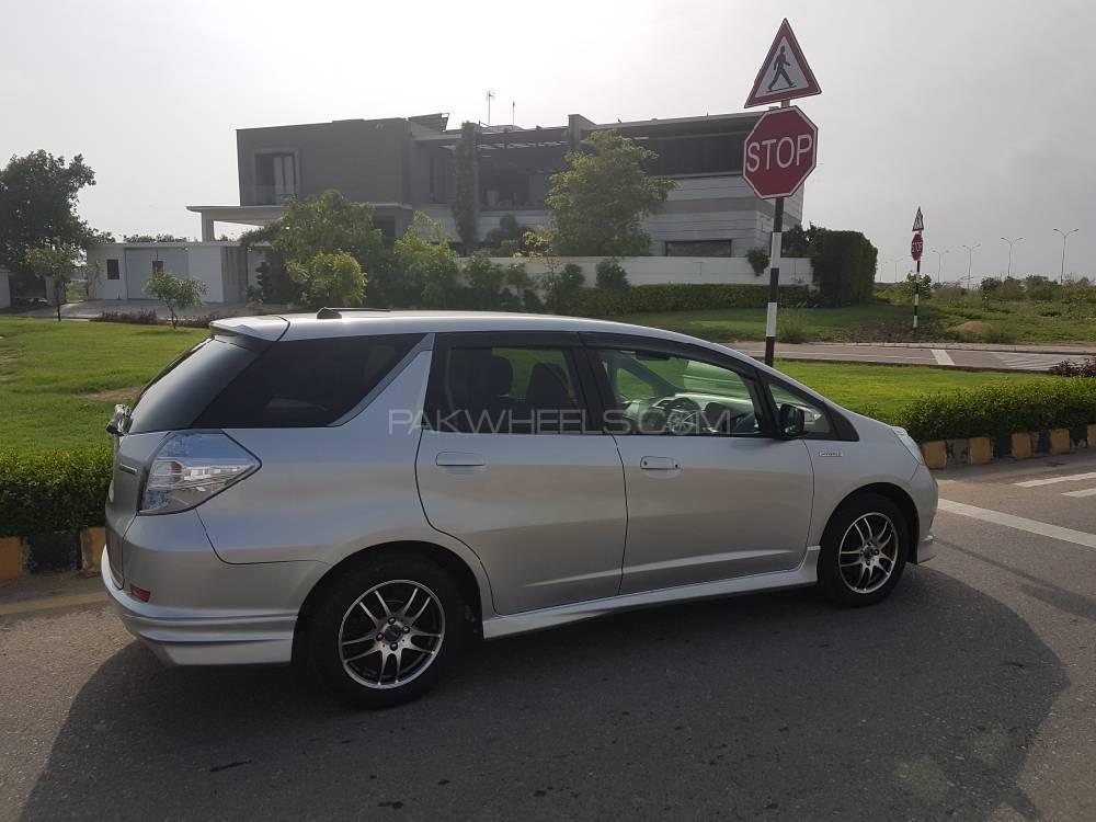 honda fit hybrid navi premium selection 2012 for sale in karachi pakwheels. Black Bedroom Furniture Sets. Home Design Ideas