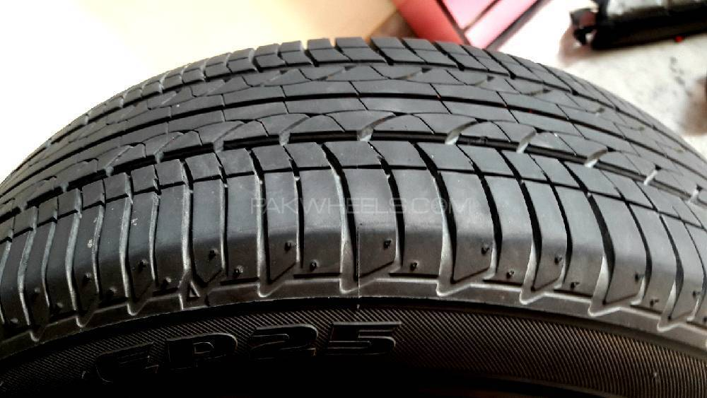 Japanese Bridgestone tyres 175/65R 15 84H with rims and cup Image-1