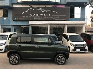®GARIWALA® Suzuki Hustler, 660C.c,  Eco-Idle stop technology, Pearl Army Green,  X-Turbo Selection Package,  5-Seater,( Sofa Seats), Model 2014,  Original 10,000 K.M, ( Verifiable ) Original DLR's ( Day Light Running LEDs ), Original HID lights, Xenon Head lamps  Original UV Glass/Windows, Auto start stop engine,  Original Suzuki 5 spoke wheel rim design, Original fog lamps, Original Leather Seat, Original Radar Braking System, Special Design Chrome Head Lights, Auto headlights, Electrical retractable side mirrors,  Push Start, Power Windows, Power Steering, Traction Control, Auto start Parking lights, Moveable/folded down Back seat(s),  Original suzuki Player, Back Camera, Genuine/ Guarantee.