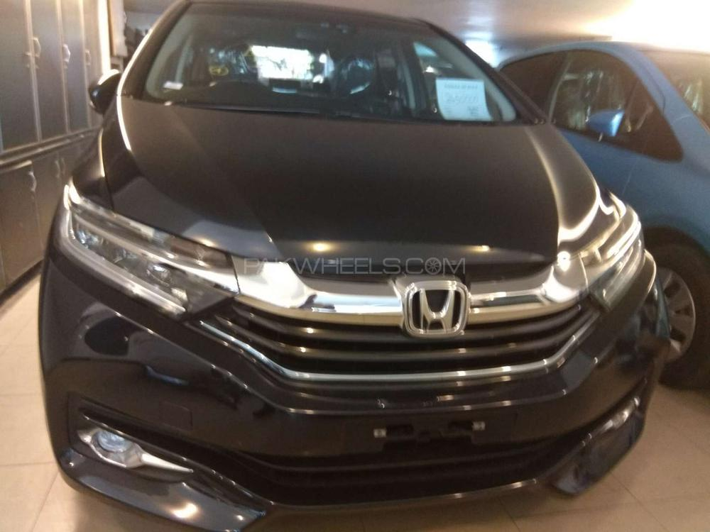 Honda fit 1 5 hybrid s package 2016 for sale in lahore for Honda finance phone number