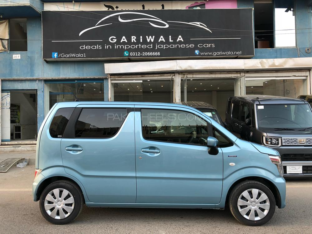 ®GARIWALA® Suzuki Wagon-R, 6th Generation New shape, 660C.c Hybrid Fx Package, Mild Hybrid Battery Technology (Hybrid), Sky/Light Blue,  FX Package, 5-Seater,( Sofa Seats), Model 2017, Fresh cleared/import 2018, Original 2200 K.M (just like 0-Meter), Key Start, Climate Conrol Air-Condition, Automatic retractable side mirrors. Power Windows, Power Steering, Traction Control, Auto-Adjustable Special Beam Head Lights, Auto headlights, Electrical retractable side mirrors, Original UV Glass/Windows, Auto start stop engine including Mild Hybrid System, Moveable Back seat(s),  umbrella holders on the inside of both rear doors. Original CD-Player,