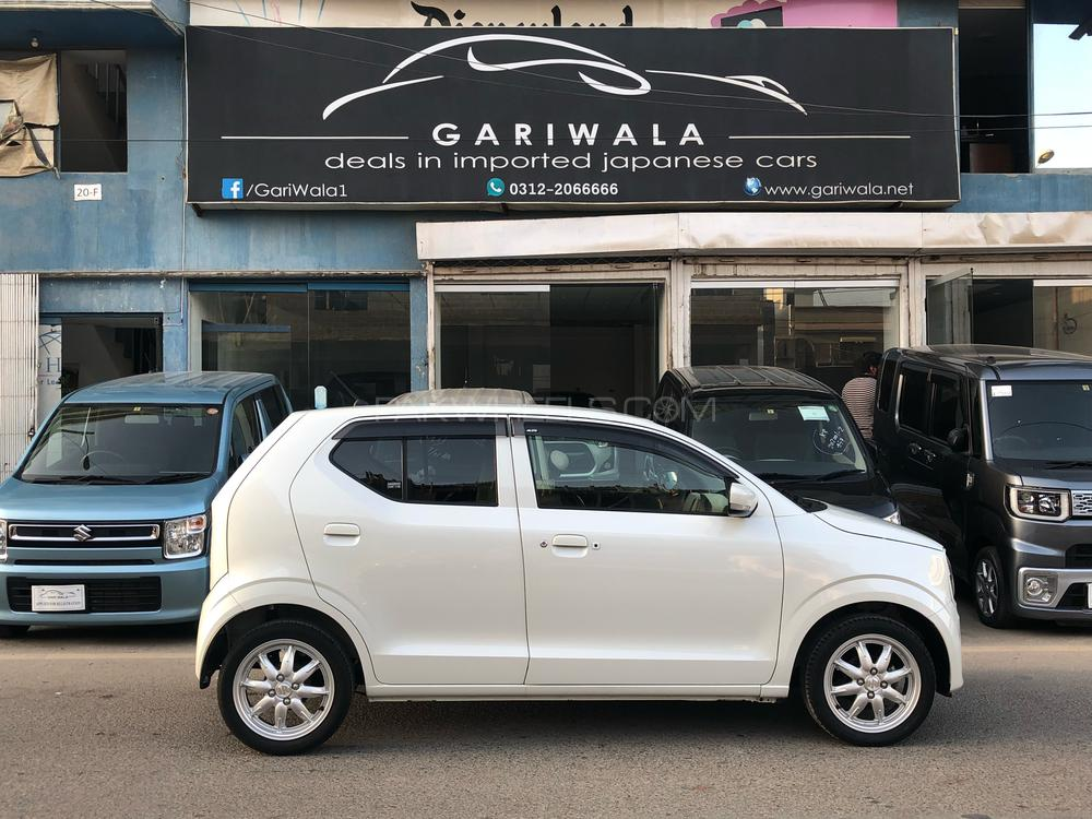 ®GARIWALA® Suzuki Alto, eNe-Charge, 660C.c,  Pearl White, Beige Interior,eNe-Charge Technology, X-Special Package, Eco- idling stop,  Model 2015, Fresh cleared/import 2018, Original 4-Grade Auction Sheet ( verifiable ), Original 39,000 K.M ( Verifiable ), Push Start, Smart Key entry, Climate Control Air-Condition, Heated Seats, Japanese Leather Seats, Original Auto-Retractable Mirrors, Chrome finish around Aircindition vents, Vehicle stability control / Traction Control, Power Steering, Power Windows,  Original Japanese Suzuki Alloy Wheels,  Safety Air-Bags,  Original CD-Player & Back Camera fitted, Original Tinted/Privacy glass,