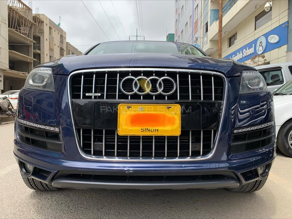 """Audi Q7 , """"S- Line PACKAGE QUATTRO"""", 3.0L V6 super charged DOHC 24-Valve, Petrol, 8-Speed automatic transmission with manual mode Mugello Blue,  Model 2013, Import 2013,••Registered KHI 2013•• Import Audi Pakistan- Premier Systems (Pvt) Ltd., Single Owner & Audi Maintained through out, Original 0-Meter K.M When Import ( Verifible ),  Original 80,000 K.M •• ( Current Mileage )•• —————EQUIPMENT/OPTIONS————— •Original Audi 18"""" 6 spoke alloy wheels. •Dual Zone Auto Climate Control Air-condioning. •Emission Standard EU2. •Special Requirements for Pakistan. •Right Hand Driver Vehicle. •Engine Cooling. •Increased battery Capacity. •Full Paint Finish. •Voice Dialogue System. •Chrome Work Package. •Lighting Package. •Servotronic. •Floor Matts at front and rear. •Tropical Zones. •First aid kit with warning  triangle. •Increase in initial standard fuel fitting. •Space-saving spare wheel. •Electric steering wheel adjustment. •Tool kit and car jack..   Complete ser"""