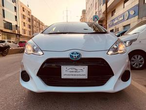 ®GARIWALA®  Toyota Aqua, Hybrid, 1500C.c Super White,  S- Package, Key Start, Model 2016, Fresh Import/cleared 2020, Original 3.5- Grade Auction Report( Verifiable ), Original 54,000 K.M ( Verifiable ), Multi-Steering, Cruise Control,  Lane Departure Assist, Radar Control,  Original Japanese tyre, Automatic Retractable Mirrors, ( indicator lights ), Traction Control,Climate Control Air conditioning, Multi-Driving Modes, Auto HID lights,  Original Foot Matts, Original Reverse/Back Camera, Original Navigation/CD/DVD Player, Sporty Hood Spoiler,Sporty Back Lights , Back Viper, Tinted Windows,