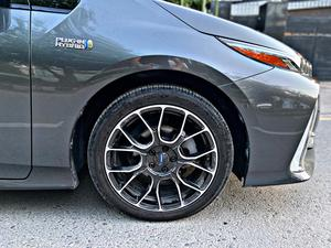 Toyota Prius PHV Prime Model Year 2017 Import Year 2020 Grey Color Plug In Hybrid Fuel Avg of 60kmpl  Original Tesla Screen Toyota Safety package Radar with distance monitor Adaptive Cruise Lane Departure Assist with Auto Steering Control Blind Spot Monitor in side mirrors Parking sensors Heating seats Heating steering Bluetooth connectivity  Rays Alloy Rims And much more