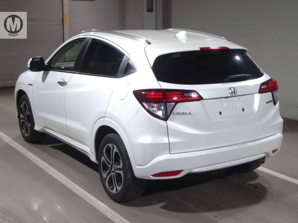 HONDA VEZEL Z SENSING 2017 MODEL PEARL WHITE COLOUR 29,000 KM GRADE 4  Merchants Automobile Karachi Branch, We Offer Cars With 100% Original Auction Report Based Cars With Money Back Guarantee.  Recommended Tips To Buy Japanese Vehicle:  1. Always Check Auction Report. 2. Verify Auction Report From Someone Else. 3. Ask For Japan Yard Pics If Possible.  MAY ALLAH CURSE LIARS..