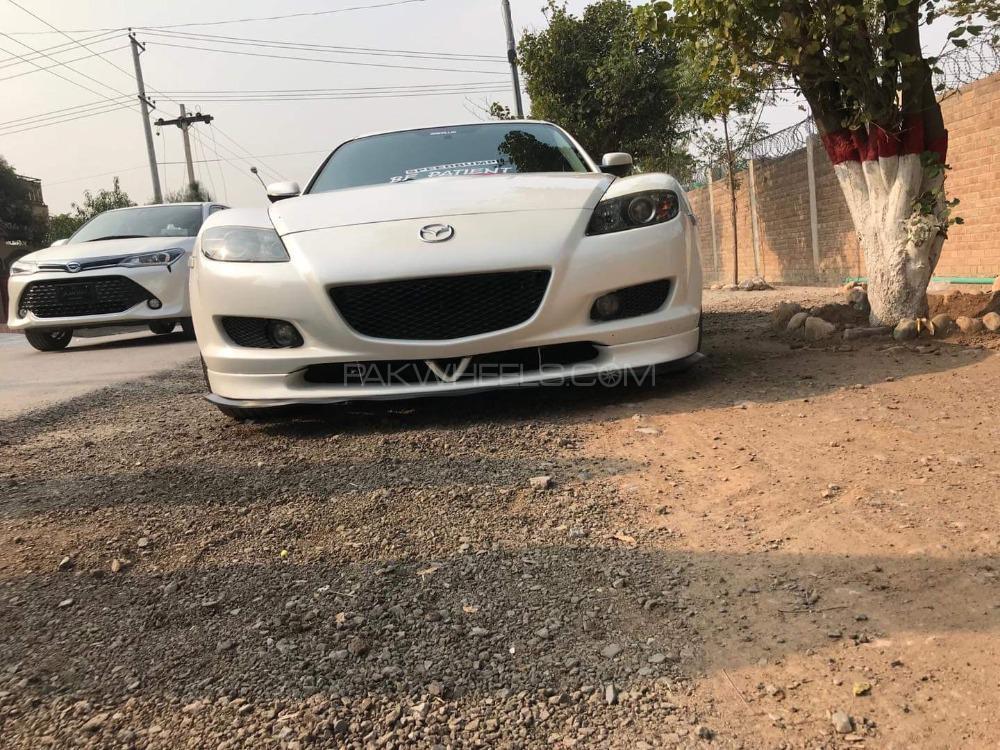 Mazda 1300 - 2003  Image-1