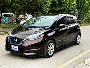 Nissan Note Burgundy Color Model Year 2016 Import Year 2020  Multimedia Steering Dedicated Camera for rear view mirror 4 Cameras with bird eye view Radar lane Departure Assist  DVD TV Alloy Wheels LED Projection Lamps Side Skirts Rear Spoiler