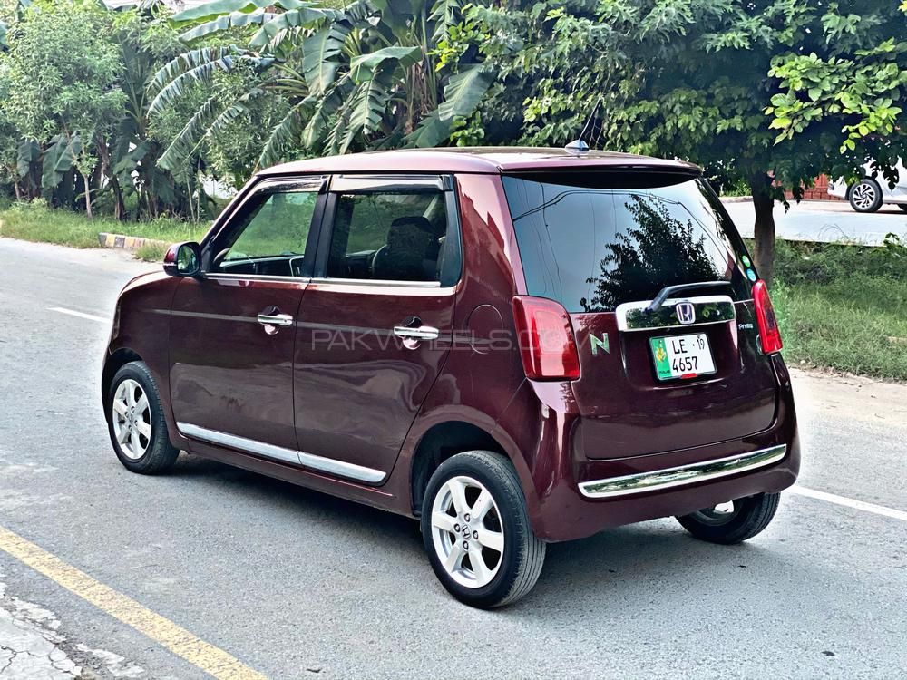 Honda N One premium Red wine color Multimedia Steering Leather seats Alloy rims Hid Projection Lamps  Fog lamps Chrome garnish And much more