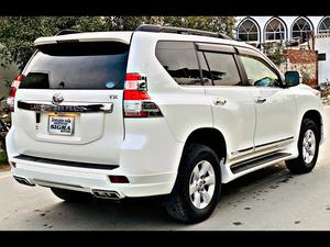 Toyota Land Cruiser Prado TX New Shape New Meter Model 2014 Import 2020  Un-Registered  Engine 2700 cc  Millage 53,000 km original  Auction Grade 4.5 Verified  Auction sheet Attached  Bumper to Bumper original Pearl White with Beige Room 7 Seater with sunroof  Beige Room  Beautiful jeep,Excellent Condition Modify with Trd Accessories. Original pics are also attached .Very care fully driven .Total Original.  Extra Accessories Full Multimedia Steering  Original DVD with Back view Camera Glass Coat  cruise control  6 Hids 100 watts with 1 year warrenty  Climate Control Dual A/C  Dvd Sound System   Trd Body kit .  Front Back trd Sports Bumper Extensions  Brand New Tire 17 Inch  Matt's original .  Back screen Spoiler  Air press  Complete chrome fitting  Chrome handles Chrome windows trims Chrome door mouldings Back light chrome shield  Key-less Entry . 100% original. Fully maintained through authorized dealership Japan