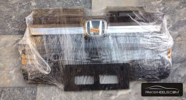 WE ARE SELLING HONDA SPARK FRONT BUMPER GRILL. Image-1