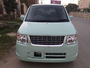 Slide_mitsubishi-ek-wagon-mx-2012-6124073